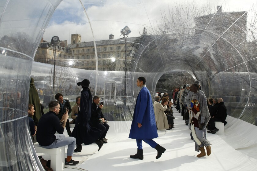 FILE - In this Feb. 26, 2020 file photo, models wear creations for the Kenzo fashion collection during Women's fashion week Fall/Winter 2020/21 presented in Paris. The coronavirus pandemic has instilled extra unpredictability into the already fickle Paris Fashion Week. After first canceling the July shows for menswear and Haute Couture, the French fashion federation has now organized an unprecedented schedule of digital-only events instead. (AP Photo/Thibault Camus, File)