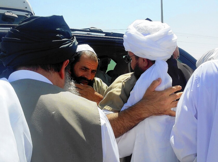 A man reported to be Mohammed Fazl, former chief of staff of the Taliban army, is welcomed at an undisclosed location in Qatar. He is considered the most dangerous of the five Taliban members freed by the U.S. last week.