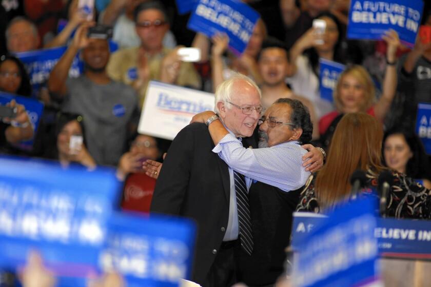 Rep. Raul M. Grijalva (D-Ariz.), right, introduces Bernie Sanders at a rally in Las Vegas on Feb. 14.