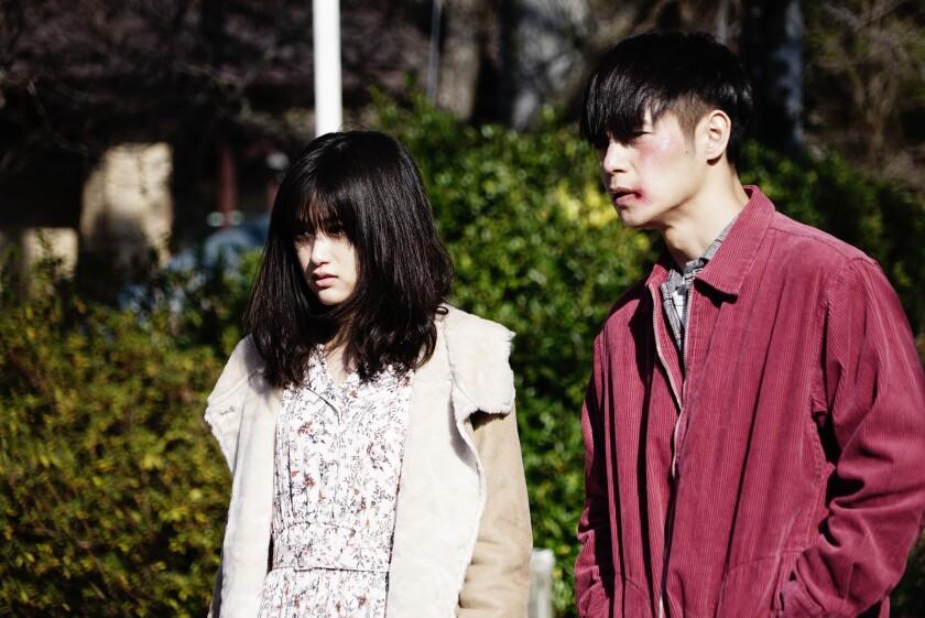 "Sakurako Konishi and Masataka Kubota in the movie ""First Love."""