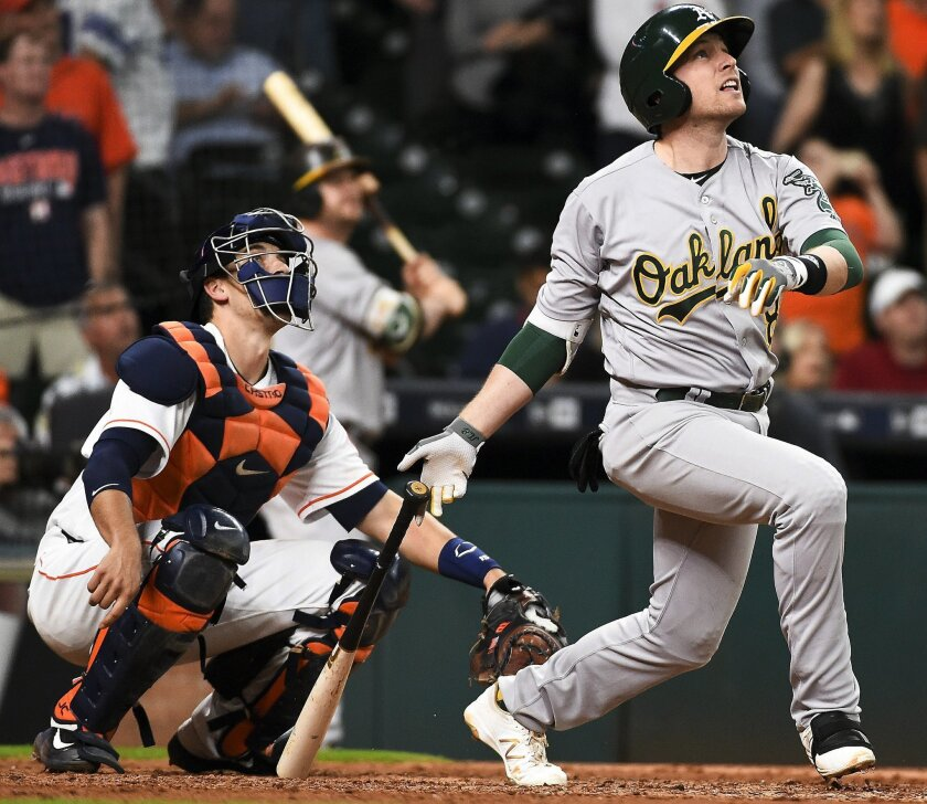 Oakland Athletics' Jed Lowrie, right, watches his game-tying home run off Houston Astros relief pitcher Luke Gregerson during the ninth inning of a baseball game, Saturday, June 4, 2016, in Houston. (AP Photo/Eric Christian Smith)