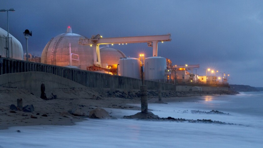 SAN CLEMENTE, CA-MARCH 25, 2014: The tide rushes in as dusk falls on the San Onofre Generating Stat