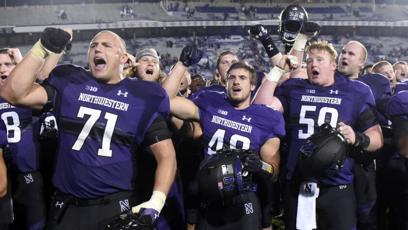 Northwestern football players celebrate after beating Duke during a nonconference game on Sept. 17.