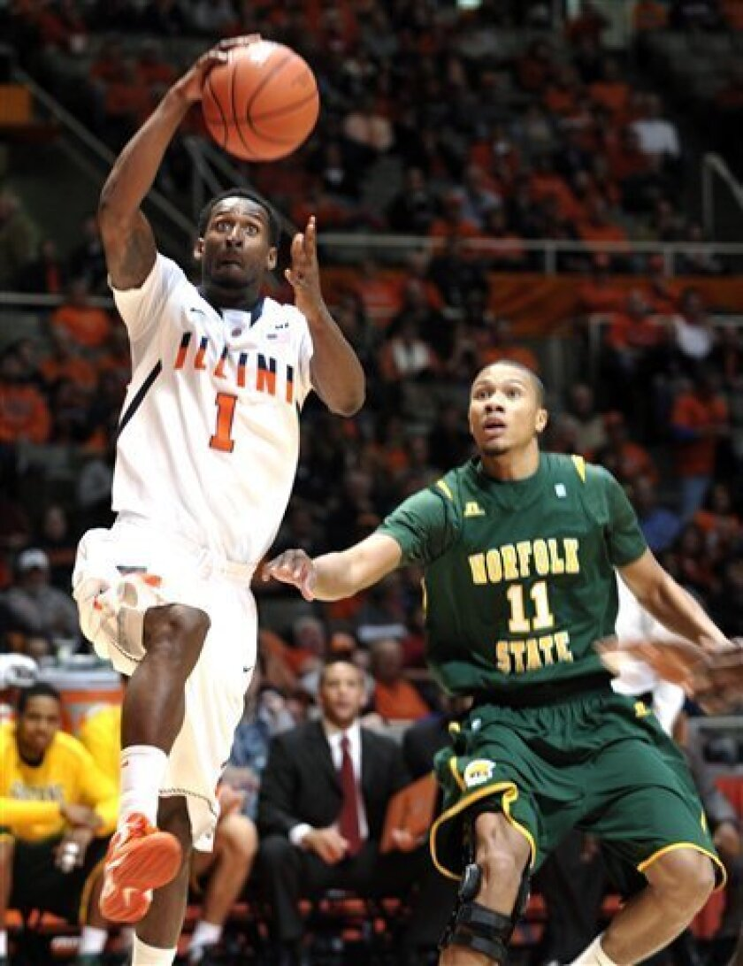Illinois' D.J. Richardson (1) breaks to the basket ahead of Norfolk State's Pendarvis Williams (11) in the first half of an NCAA college basketball game at Assembly Hall in Champaign, Ill., Tuesday Dec. 11, 2012. (AP Photo/John Dixon)
