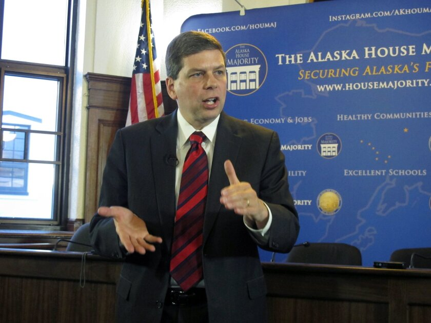 In this March 3, 2014 file photo U.S. Sen. Mark Begich, D-Alaska, addresses reporters during a news conference after he spoke to a joint session of the Alaska Legislature in Juneau, Alaska. Television ads in Alaska's U.S. Senate race have been pulled by the two major party candidates after complaints from the family of two slaying victims, Tuesday, Sept. 2, 2014. U.S. Sen. Mark Begich, D-Alaska, began airing an ad last week trying to portray his Republican opponent, former Alaska Attorney General Dan Sullivan, as soft on crime. Sullivan swiftly responded with an ad of his own, accusing Begich of trying to use the case for political gain. (AP Photo/Becky Bohrer, File)