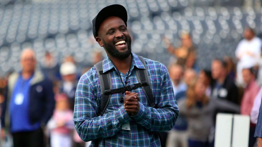 Former Dodger Tony Gwynn Jr. hangs out before the start of the game between the Padres and the Dodgers Friday.