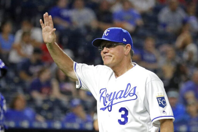 Kansas City Royals manager Ned Yost acknowledges the crowd as he walks to the dugout after making a pitching change during the eighth inning of a baseball game against the Atlanta Braves Tuesday, Sept. 24, 2019, in Kansas City, Mo. Yost announced Monday that he is retiring at the end of the season. (AP Photo/Charlie Riedel)