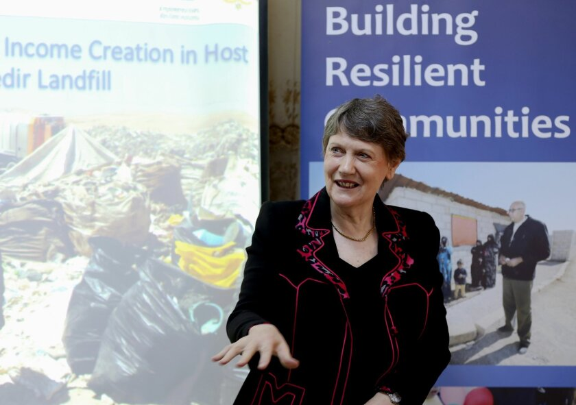 """The head of the U.N. Development Program, Helen Clark, speaks during her visit to the Al-Akedir landfill, near the Syrian border, during a tour of northern Jordan on Sunday, Nov. 8, 2015. Clark says she is """"beating the drum"""" for a new deal for Syrian refugees that will help them make a living close"""
