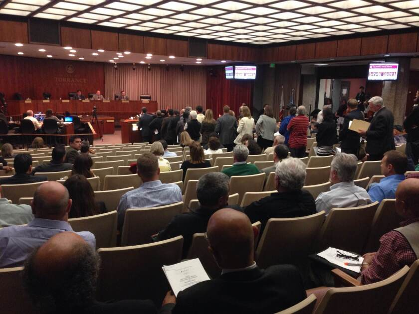 Dozens of audience members line up to speak during the public comment period. State senators held a hearing Thursday night about a Feb. 18 explosion at the Exxon Mobil refinery in Torrance.