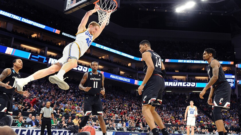 UCLA center Thomas Welsh throws down a dunk against Cincinnati in the second half of an NCAA tournament game March 19.