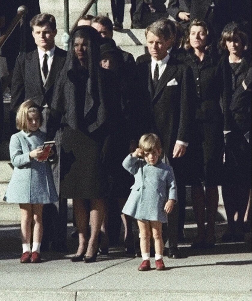 FILE - In this Nov. 25, 1963 file photo, three-year-old John F. Kennedy Jr., salutes his father's casket in Washington, three days after the president was assassinated in Dallas. Widow Jacqueline Kennedy, center, and daughter Caroline Kennedy are accompanied by the late president's brothers Sen. Edward Kennedy, left, and Attorney General Robert Kennedy. A documentary film on John Kennedy Jr.'s life opens Friday, July 22, 2016, in select theaters. It also airs on Spike TV at 9 p.m. EDT on Aug. 1, and a DVD release is set for Aug. 16. (AP Photo, File)