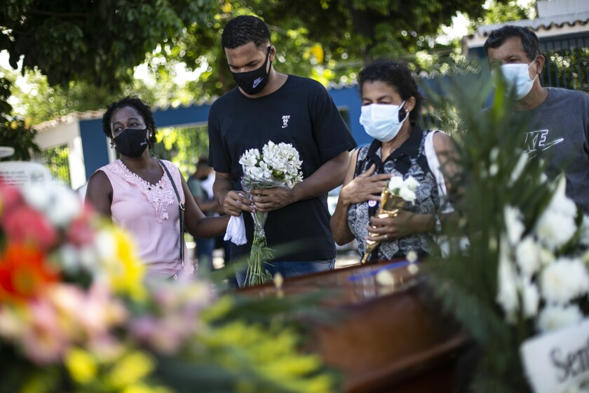 Relatives attend the burial of COVID-19 victim in Brazil
