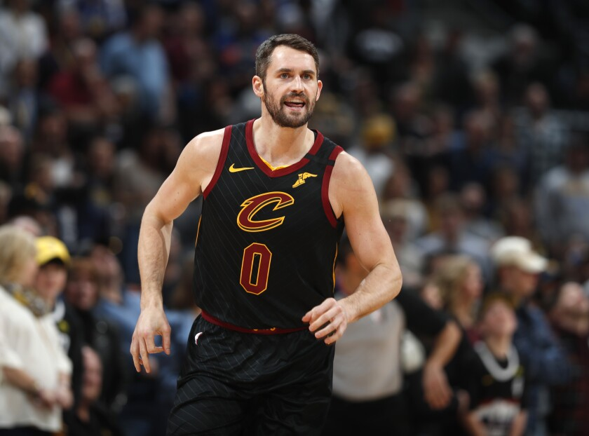 FILE - In this Jan. 11, 2020, file photo, Cleveland Cavaliers forward Kevin Love heads up the court after making a 3-point basket against the Denver Nuggets during the first half of an NBA basketball game in Denver. The Cleveland Cavaliers weren't invited inside the NBA's Disney World summer bubble. They never want to have the door close on them again. One of eight teams whose season ended by the league's decision to resume play in a controlled atmosphere in Florida next month, the Cavs are using their omission as fuel for the future. (AP Photo/David Zalubowski, File)