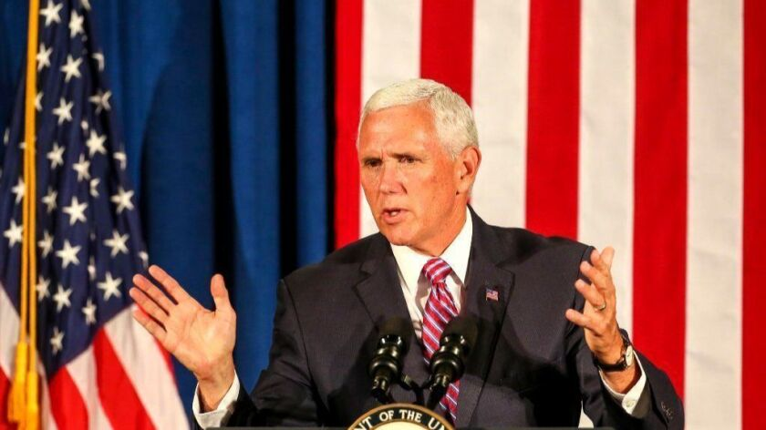 Vice President Mike Pence, shown Thursday at an Orlando rally for Florida Gov. Rick Scott's Senate run, has again denied authorship of a stinging anonymous op-ed published last week.