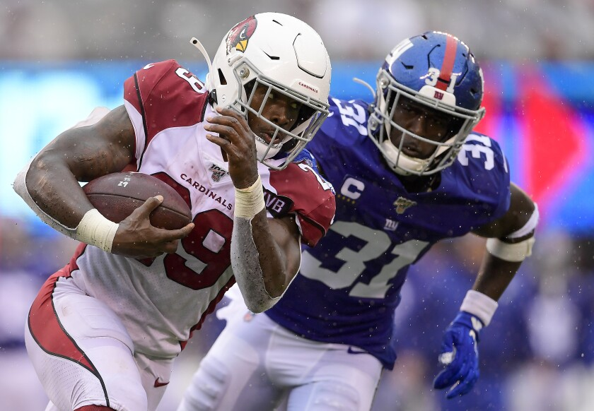 Arizona Cardinals running back Chase Edmonds sprints in front of New York Giants safety Michael Thomas during the Cardinals' win Sunday.