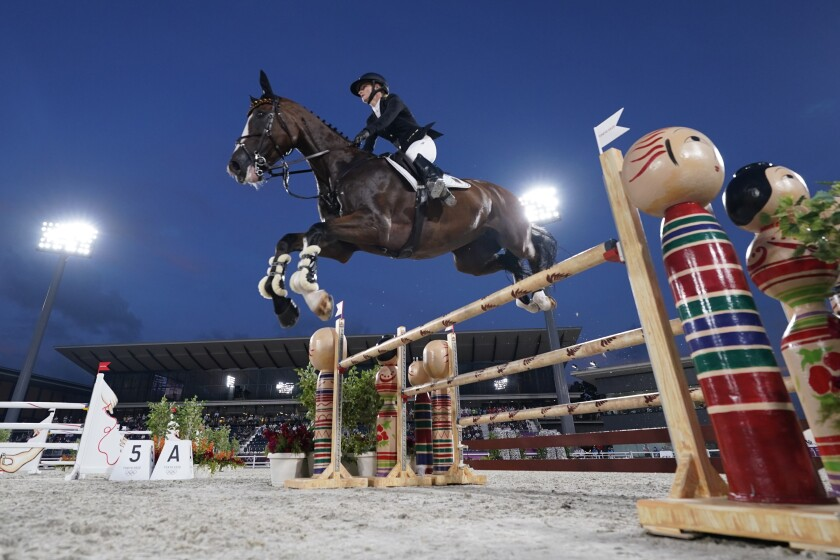 Germany's Julia Krajewski, riding Amande de B'Neville, competes during the Equestrian Eventing Jumping competition during the 2020 Summer Olympics, Monday, Aug. 2, 2021, in Tokyo, Japan. (AP Photo/Carolyn Kaster)