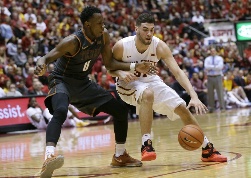 Iowa State forward Georges Niang drives past Texas guard Tevin Mack, left, during the first half of an NCAA college basketball game Saturday, Feb. 13, 2016, in Ames, Iowa. (AP Photo/Charlie Neibergall)
