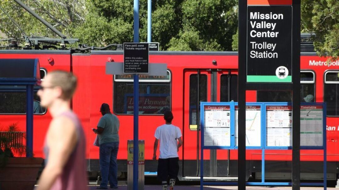 The San Diego Trolley arrives at the Mission Valley Center Trolley Station.