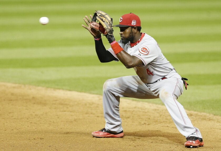 Cincinnati Reds' Brandon Phillips catches a ball hit by Cleveland Indians' Carlos Santana in the sixth inning of a baseball game, Friday, May 22, 2015, in Cleveland. Santana was out on the play. (AP Photo/Tony Dejak)