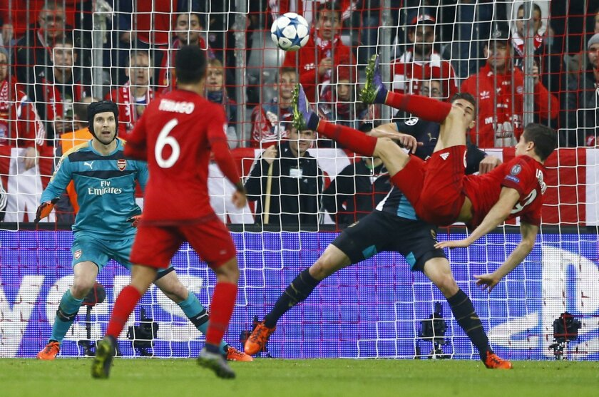 Bayern's Robert Lewandowski performs a scissor kick during the Champions League Group F soccer match between Bayern Munich and Arsenal FC in Munich, southern Germany, Wednesday, Nov. 4, 2015. (AP Photo/Matthias Schrader)