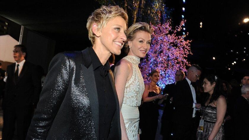 Ellen DeGeneres, left, and Portia de Rossi, at the 2014 Oscars' Governors Ball, bought their Hollywood Regency-style house in September.