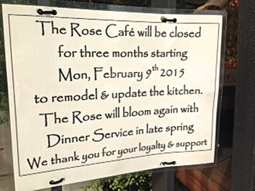 The sign in the front window announcing the closing of the Rose Cafe.