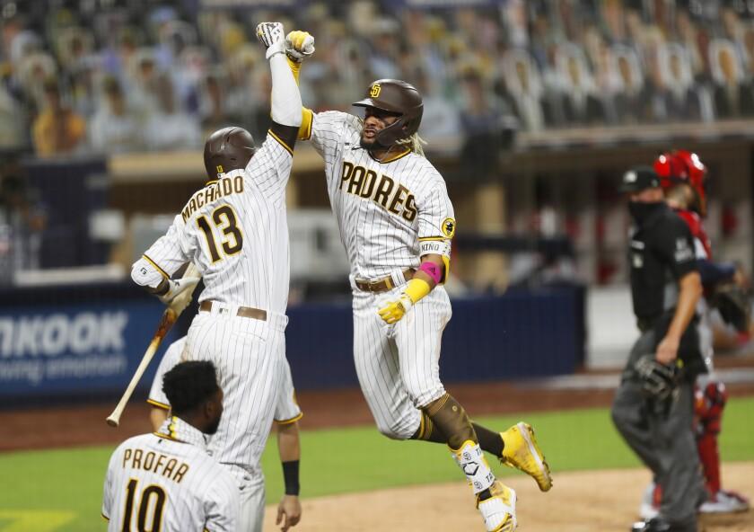 Fernando Tatis Jr. of the San Diego Padres celebrates a home run with Manny Machado.