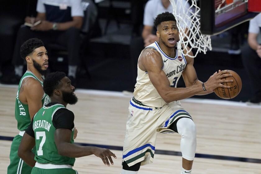 The Bucks' Giannis Antetokounmpo drives to the basket July 31, 2020.