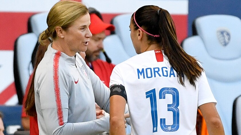 U.S. coach Jill Ellis speaks to star forward Alex Morgan during a Tournament of Nations games in Kansas City, Kan., on July 26.