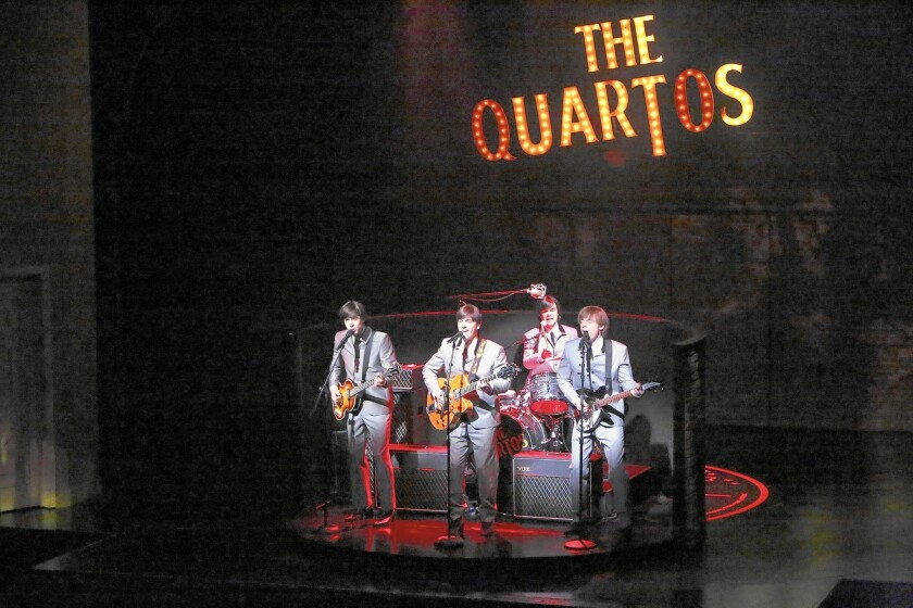 """The Quartos perform -- Claude (Damon Daunno), Balth (Lucas Papaelias), Pedro (James Barry) and Ben (Justin Kirk) -- in a scene from the play """"These Paper Bullets!"""""""