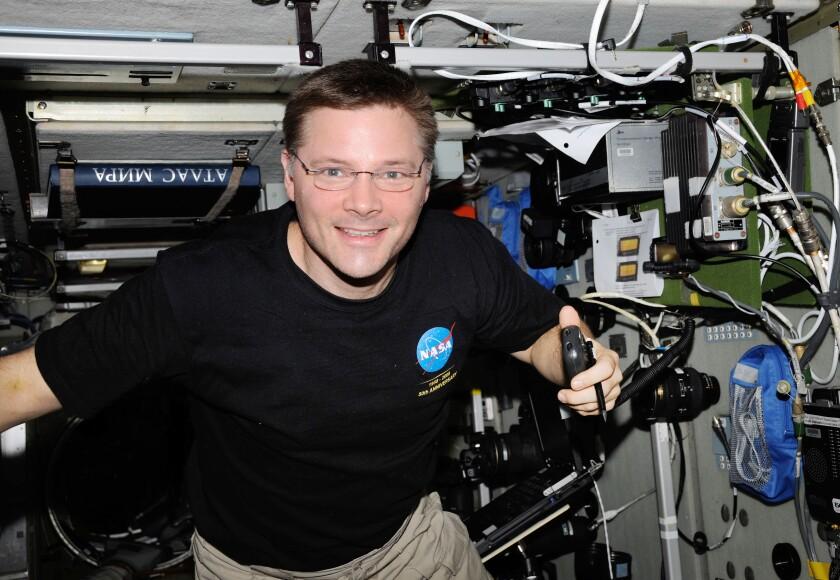 NASA astronaut Doug Wheelock uses a ham radio system at the International Space Station.