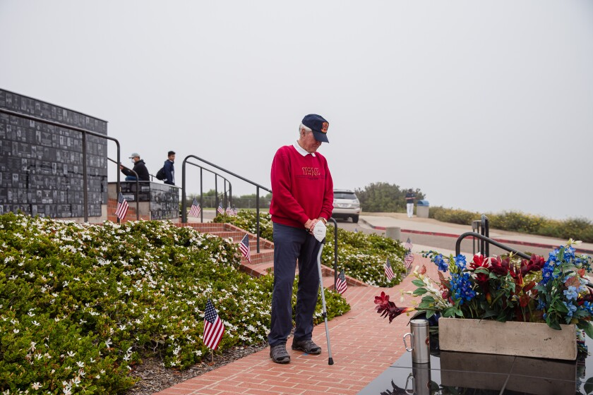 Retired Marine Lt. Col. Tony Anthony pauses at Mount Soledad National Veterans Memorial on May 25 to pay tribute to those with whom he fought in the Vietnam War. Johnson served two tours in Vietnam and was in the service for 43 years.