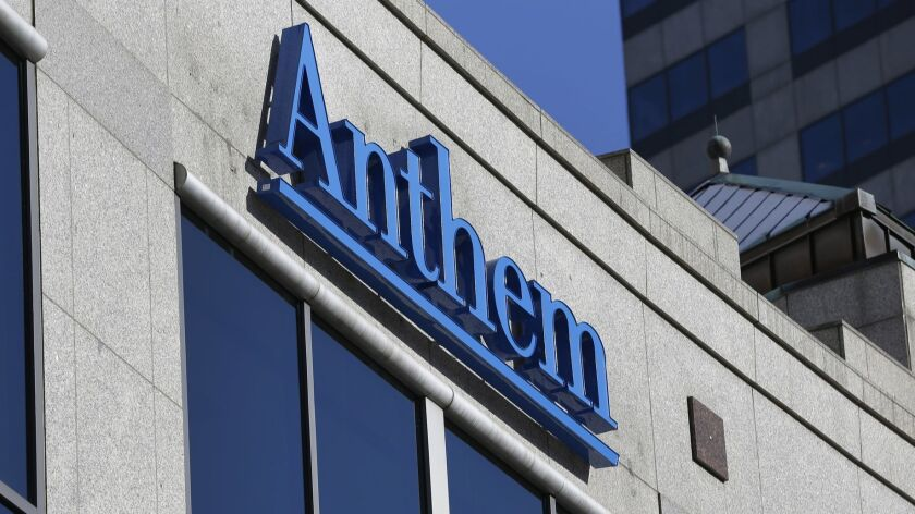 FILE - In this Thursday, Feb. 5, 2015, file photo, the Anthem logo hangs at the health insurer's cor