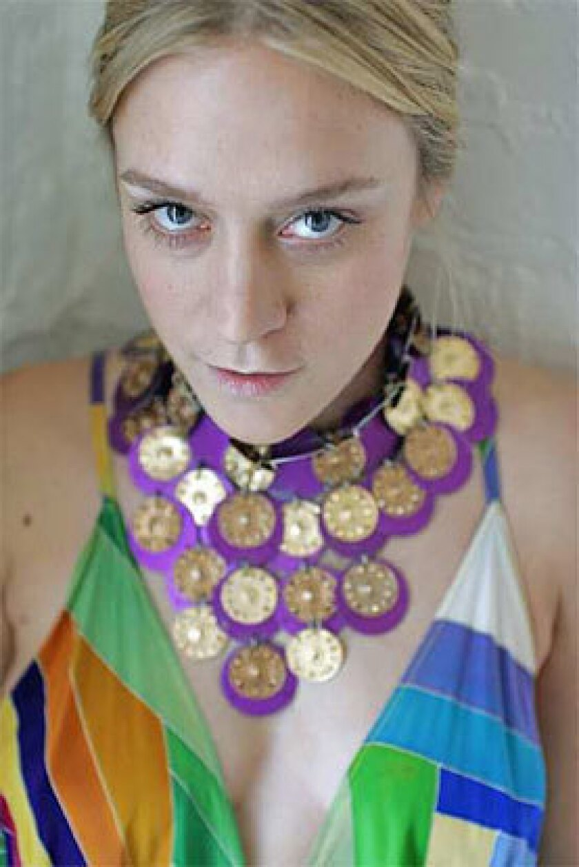 Sevigny wears a Paco Rabanne Haute Couture dress and collar.