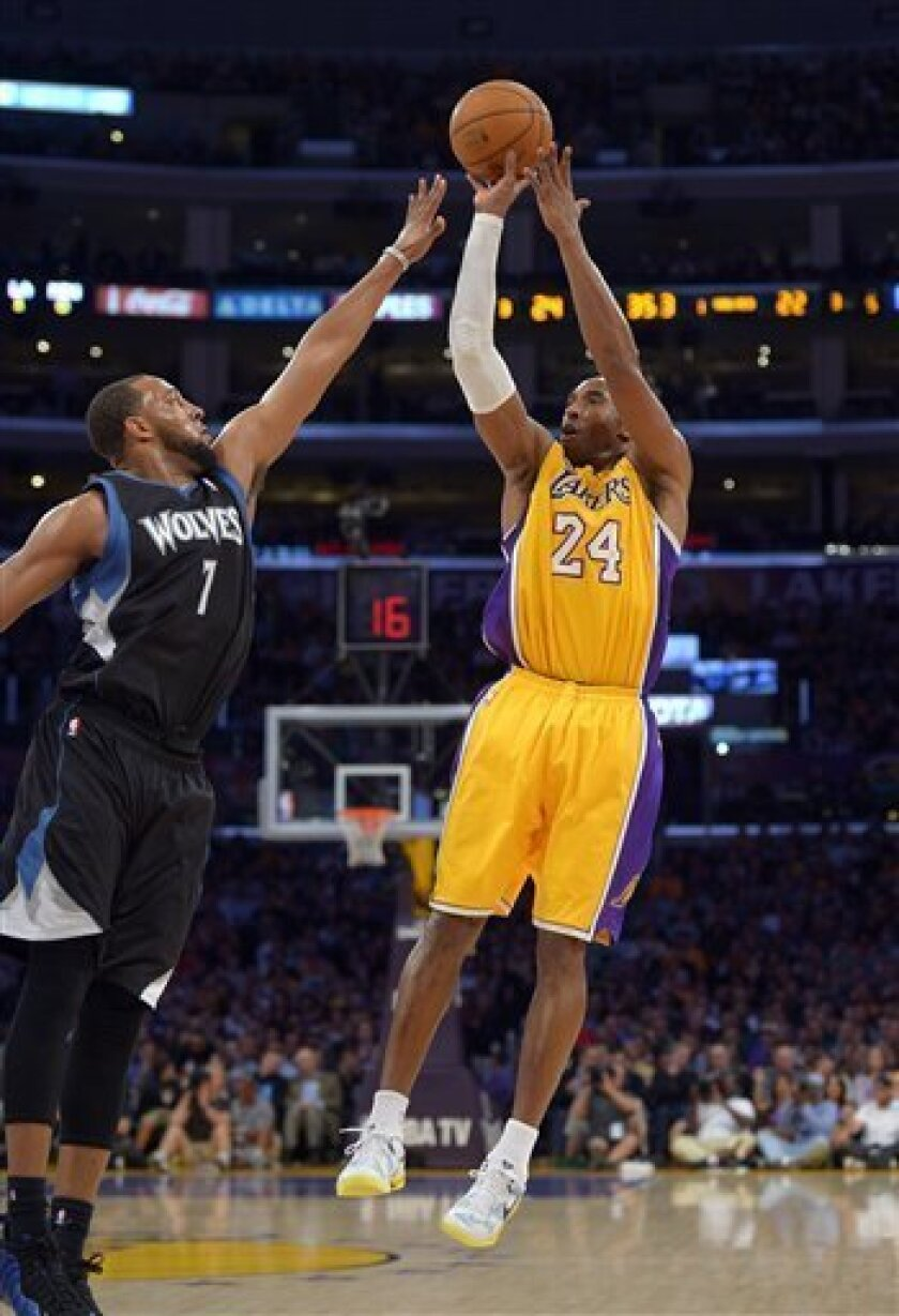 Los Angeles Lakers guard Kobe Bryant, right, puts up a shot as Minnesota Timberwolves forward Derrick Williams defends during the first half of their NBA basketball game, Thursday, Feb. 28, 2013, in Los Angeles.  (AP Photo/Mark J. Terrill)