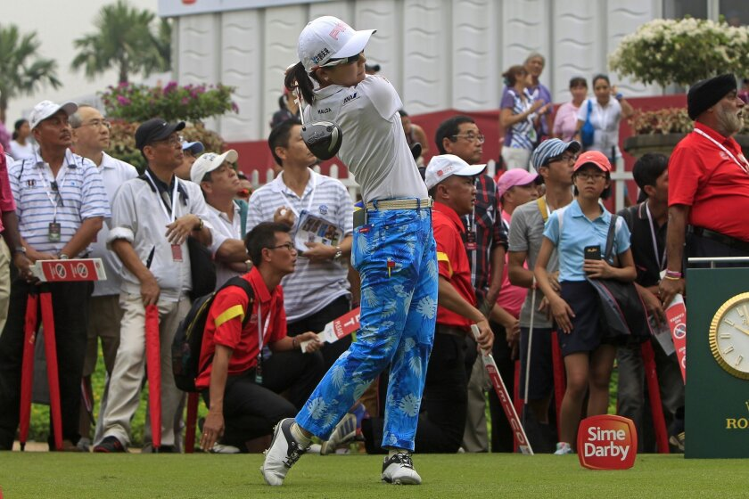 Ayako Uehara of Japan tees off on the first hole during the third round of the LPGA Malaysia golf tournament at Kuala Lumpur Golf and Country Club in Kuala Lumpur, Malaysia, Saturday, Oct. 11, 2014. (AP Photo/Lai Seng Sin)