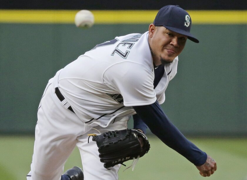 Seattle Mariners starting pitcher Felix Hernandez throws to a Los Angeles Angels batter during the fourth inning of a baseball game, Thursday, July 9, 2015, in Seattle. (AP Photo/Ted S. Warren)