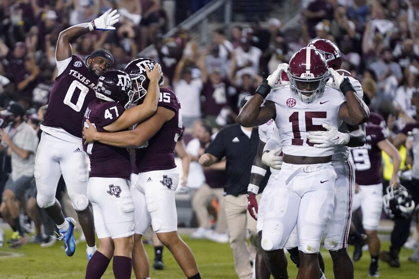 Texas A&M's Seth Small (47) celebrates with Nik Constantinou (95) and Ainias Smith (0) after his game-winning field goal, as Alabama linebackers Dallas Turner (15) and Will Anderson Jr. leave the field after an NCAA college football game Saturday, Oct. 9, 2021, in College Station, Texas. (AP Photo/Sam Craft)