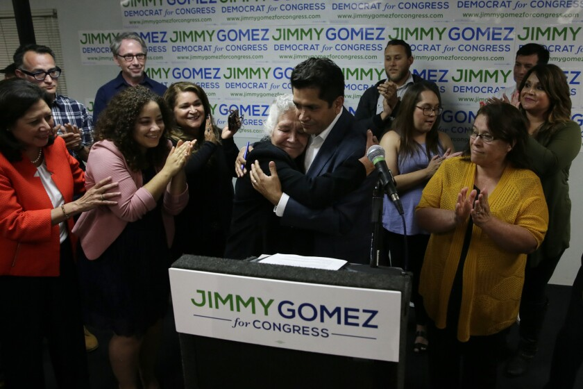 Assemblyman Jimmy Gomez embraces his mother, Soccoro Gomez Martinez, after speaking to supporters at