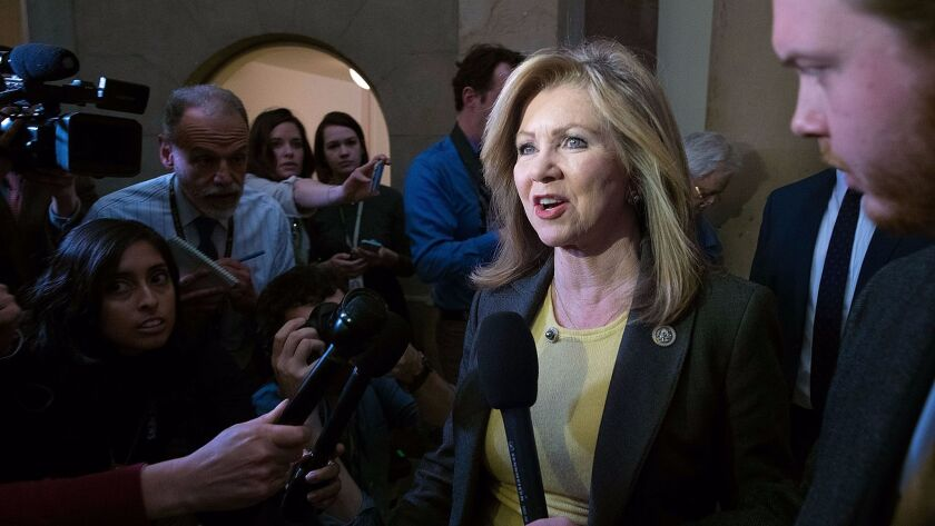 WASHINGTON, DC - MARCH 23: Rep. Marsha Blackburn (R-TN) is surrounded by reporters after leaving th
