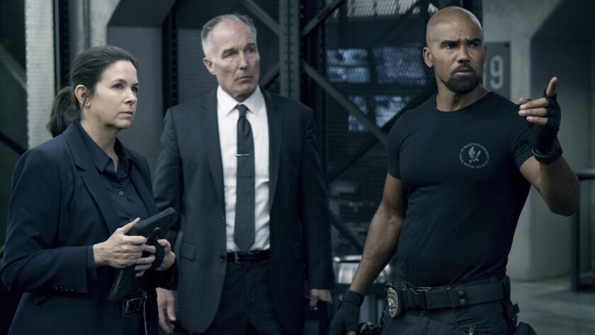 """Amy Farrington, Patrick St. Esprit and Shemar Moore in """"S.W.A.T."""" on CBS."""