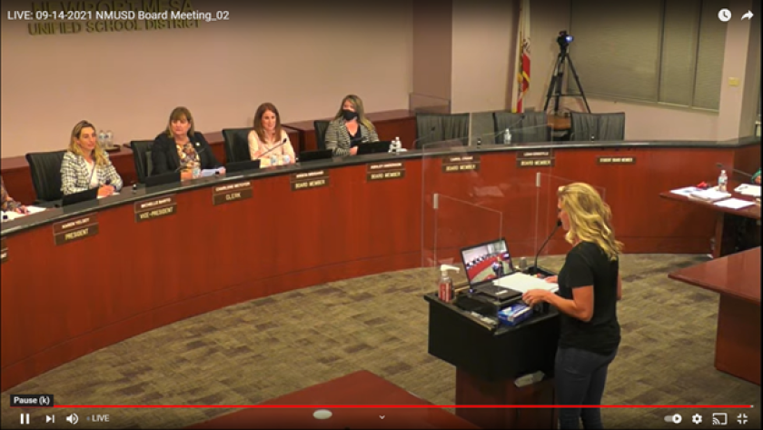 NMUSD parent Chris Jones, right, addresses board members in a meeting Tuesday.