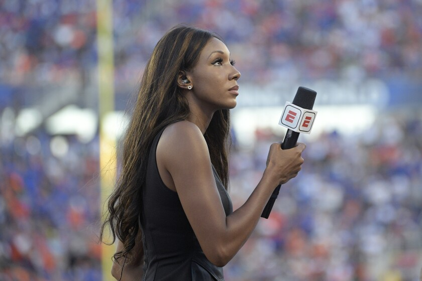 """FILE - In this Aug. 24, 2019, file photo, ESPN's Maria Taylor works from the sideline during the first half of an NCAA college football game between Miami and Florida in Orlando, Fla. Taylor is leaving ESPN after the two sides were unable to reach an agreement on a contract extension. Taylor had been with ESPN since 2014 but her contract expired Tuesday, July 20, 2021. Her last assignment for the network was Tuesday night at the NBA Finals, where she was the pregame and postgame host for the network's """"NBA Countdown"""" show. (AP Photo/Phelan M. Ebenhack, File)"""