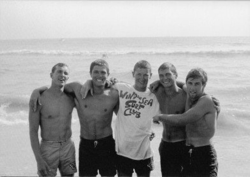 WindanSea Surf Club members Mike Burner, Butch Van Artsdalen, Rusty Miller, Bill David and Billy Caster pose after winning the paddle relay team contest during the 1963 West Coast Surfing Championships in Huntington Beach.  Photo by Ron Church