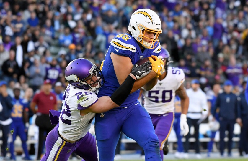 Chargers tight end Hunter Henry catches a pass against the Minnesota Vikings.