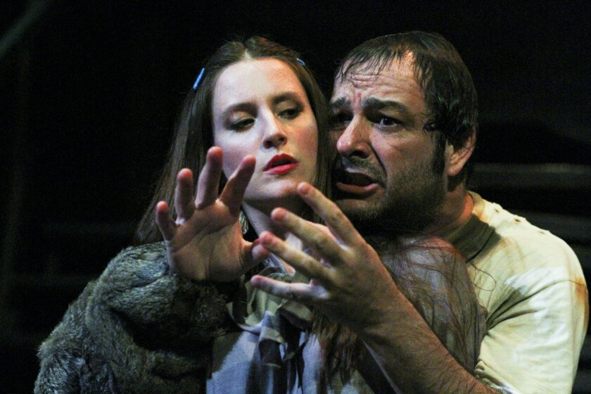 """Kelly Iversen and Manny Fernandes in New Village Arts Theatre's """"Buried Child."""""""