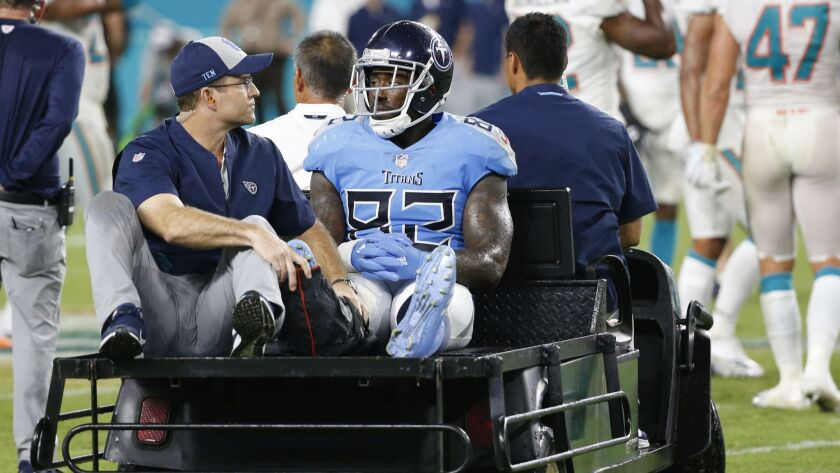 Tennessee Titans tight end Delanie Walker (82) is driven off the field after he injured his leg during the second half against the Miami Dolphins.