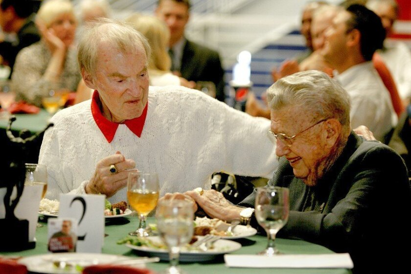 Don Coryell talks with San Diego Hall of Champions founder Bob Breitbard at a luncheon at the Balboa Park sports museum in July 2009.