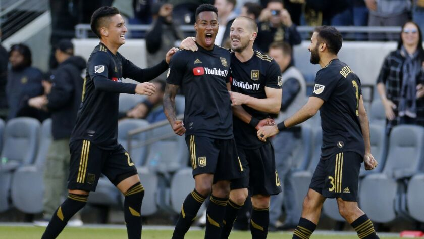 Los Angeles FC midfielder Mark-Anthony Kaye, second from left, of Canada, celebrates his goal with t