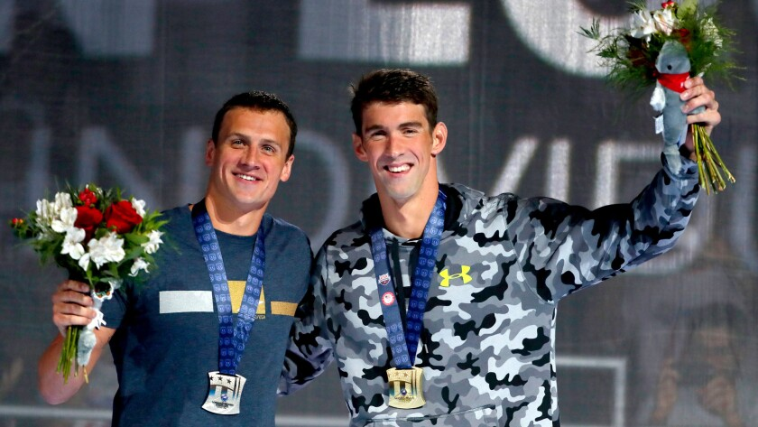 Ryan Lochte, left, and Michael Phelps celebrate on the podium together after the 200-meter individual medley at the U.S. Olympic swimming trials on Friday night.